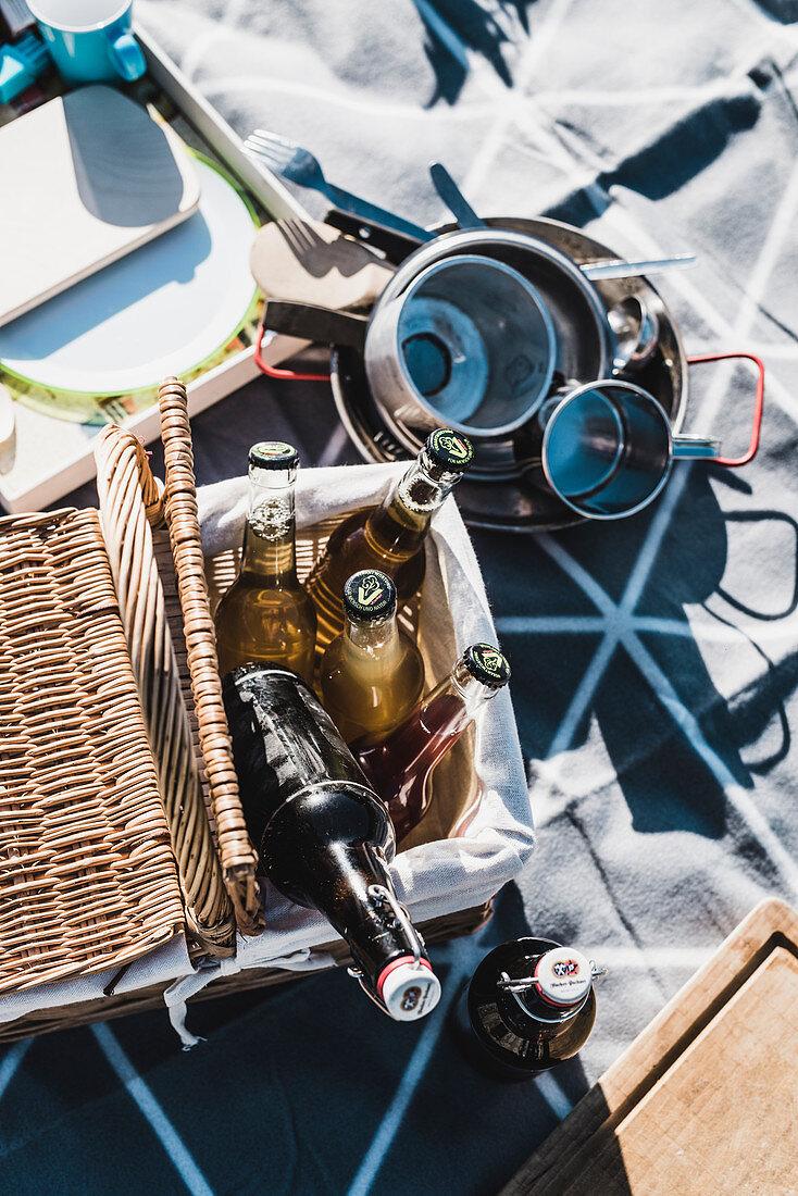 Various bottles in a picnic basket