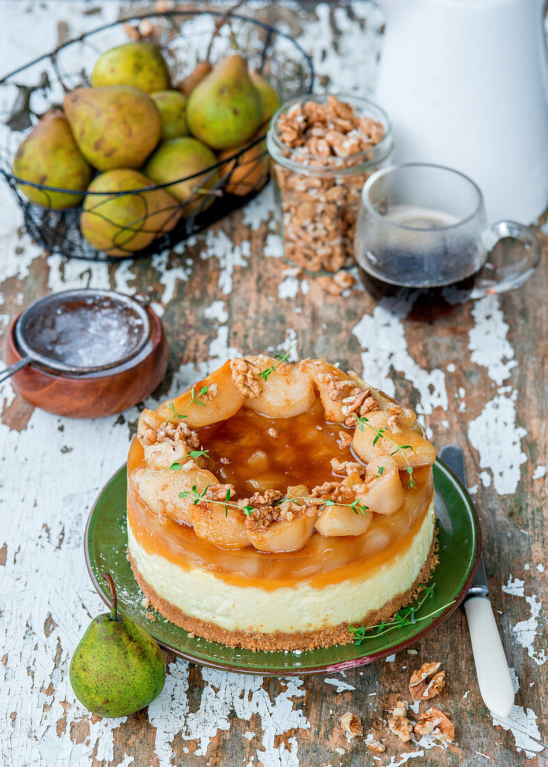 Autumnal cheesecake with pears and walnuts