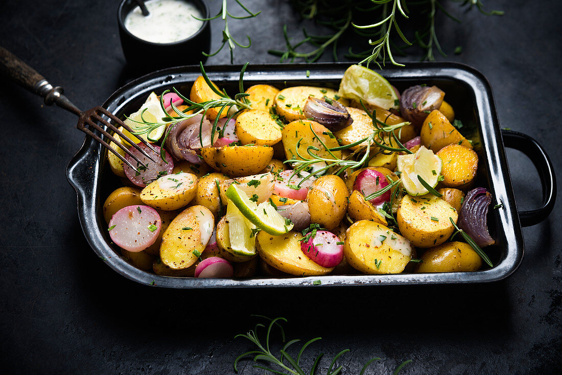 Oven-roasted potatoes, radishes and red onions with rosemary and lime