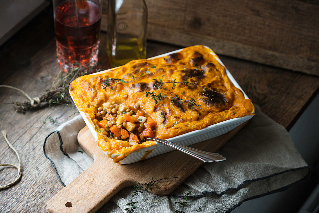 Vegan shepherd's pie made with potatoes and sweet potatoes filled with lentils, carrots and celery