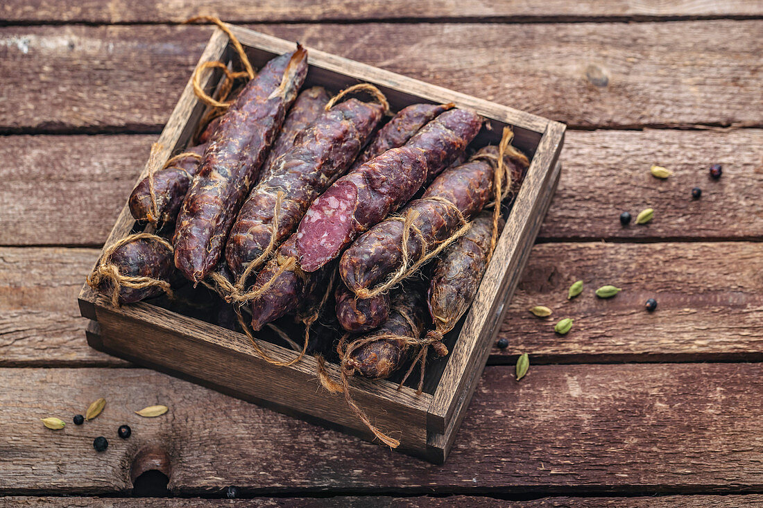 Dry-cured sausages in a wooden box