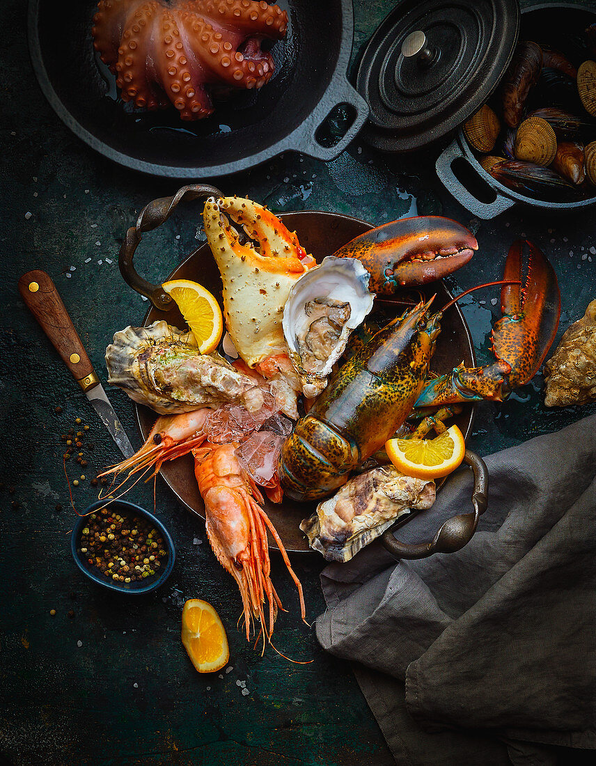 Seafood, fresh and cooked, with oranges and spices