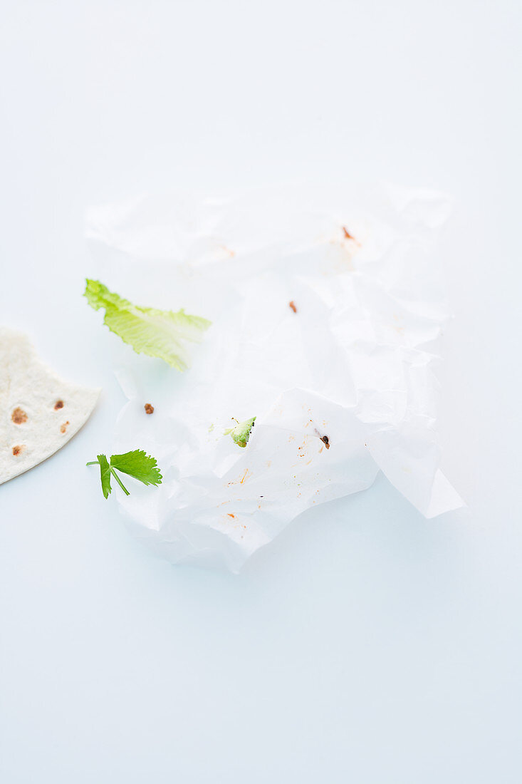 Crumpled paper and the remains of a burrito