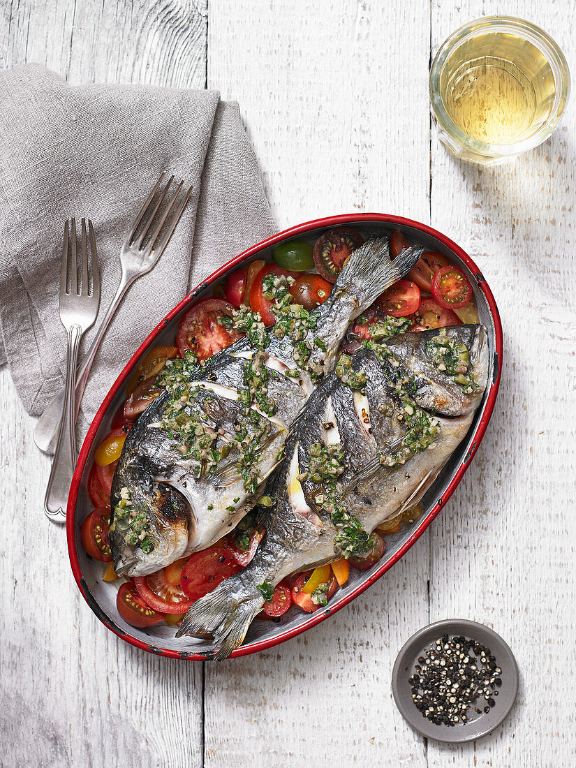 Grilled fish on a tomato medley