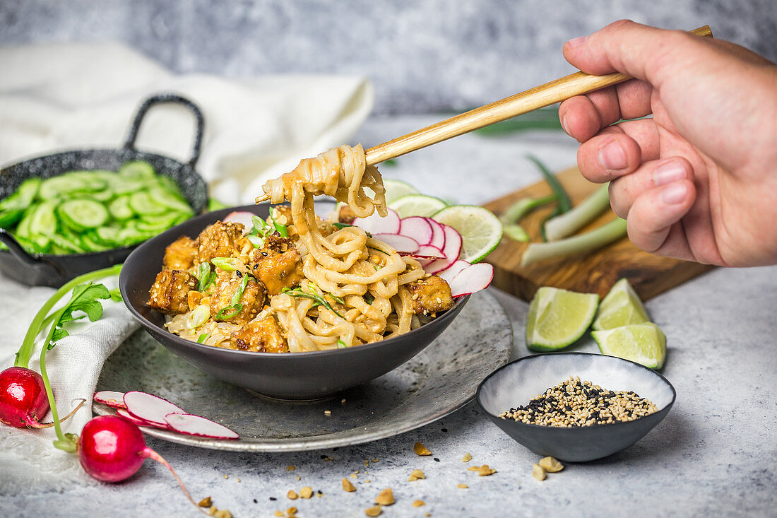 Tofu and Noodles with Peanut Sauce and Cucumbers with Chopsticks