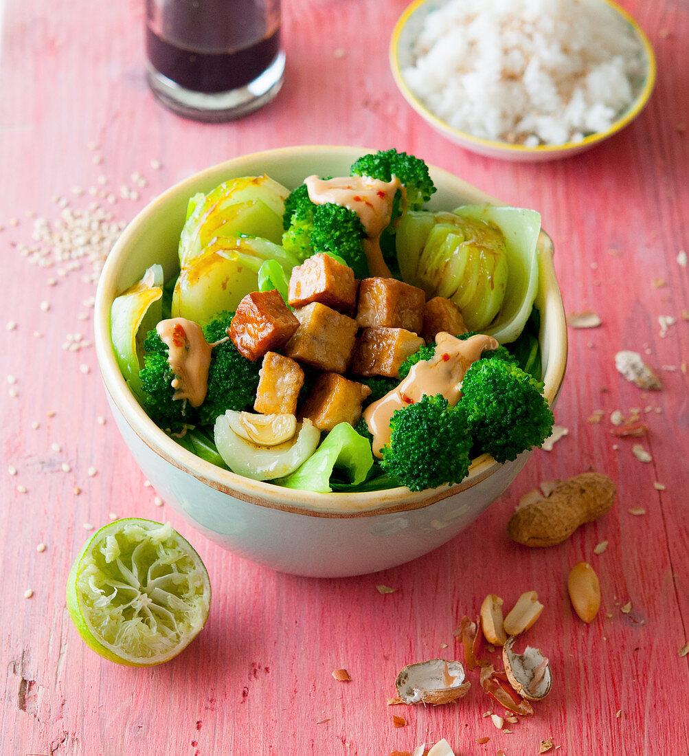 Asia bowl with bok choy, tofu, broccoli and chilli-peanut sauce