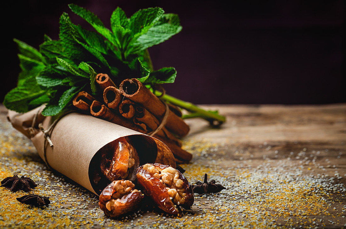 Dates fruits with walnuts, mint and cinnamon muslim halal snack for Ramadan