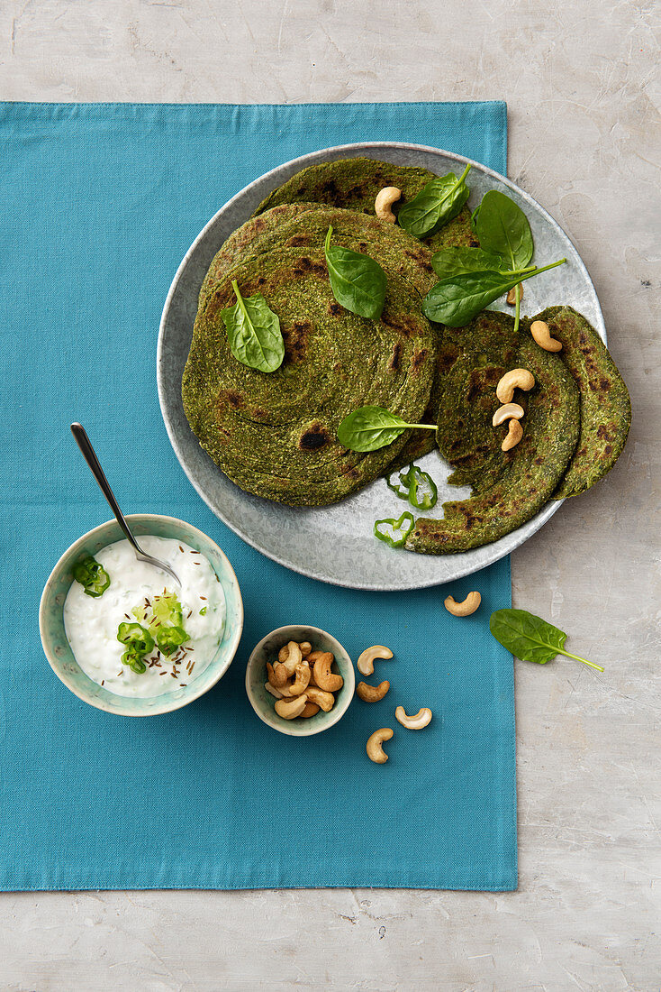 Indian spinach and cashew nut paratha with raita