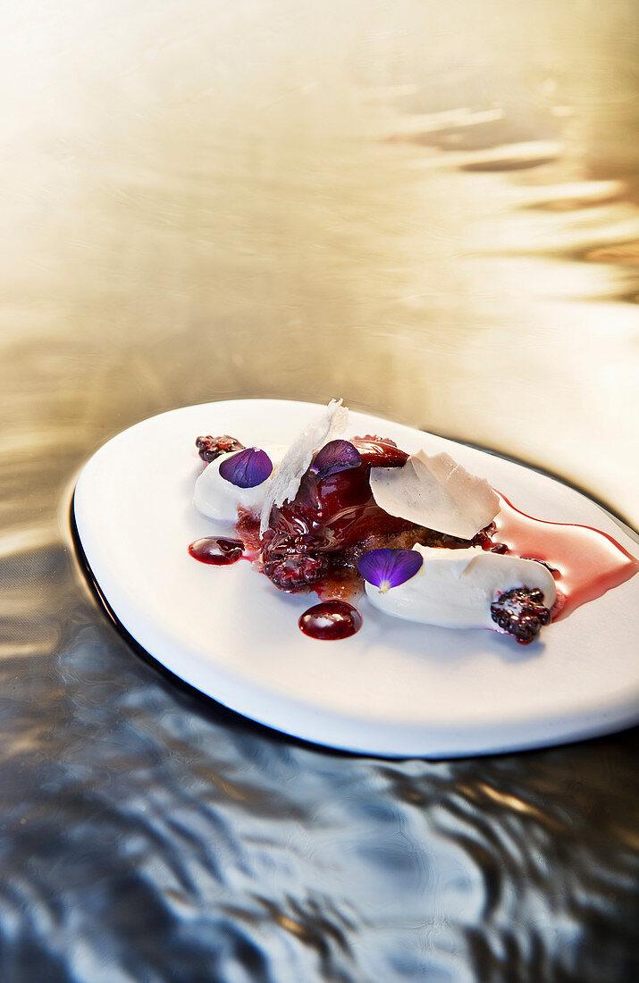 Natural cuisine: summery birch cream dessert with wild blackberries