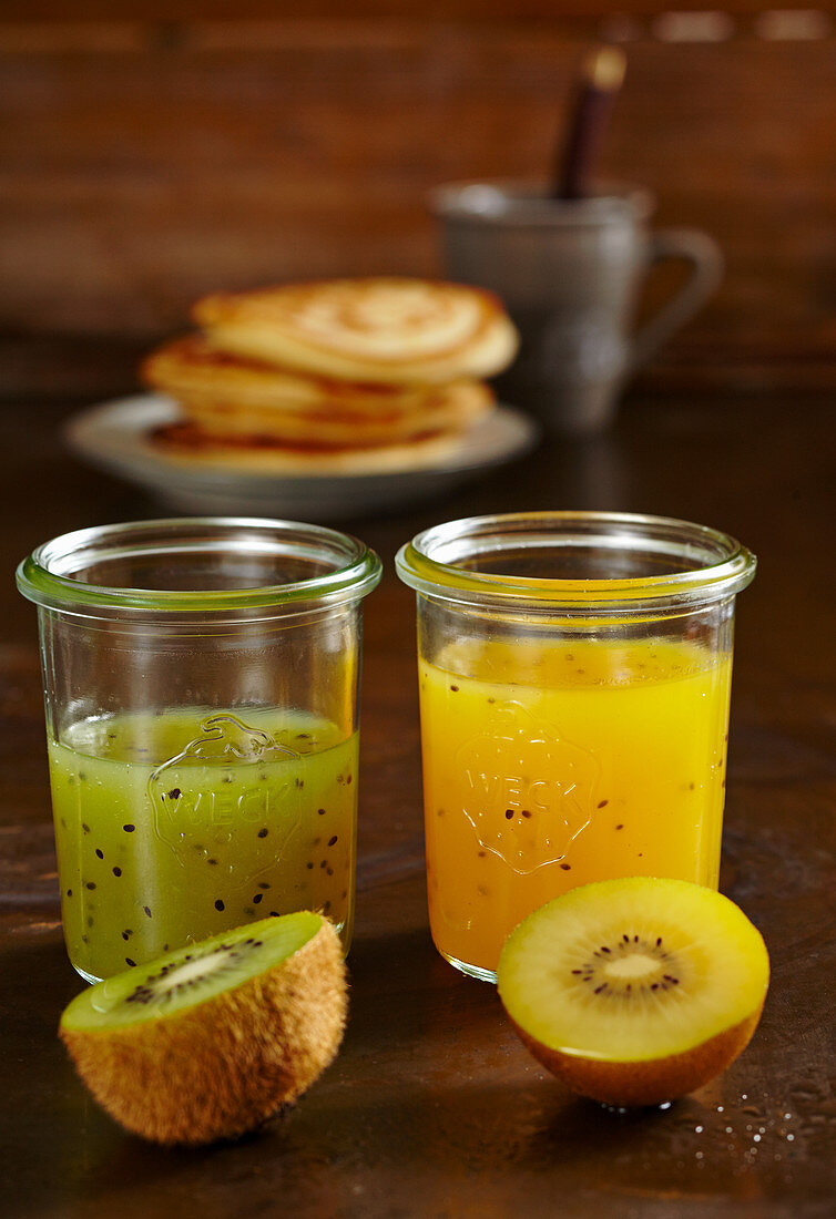 Glasses of homemade yellow and green kiwi syrup