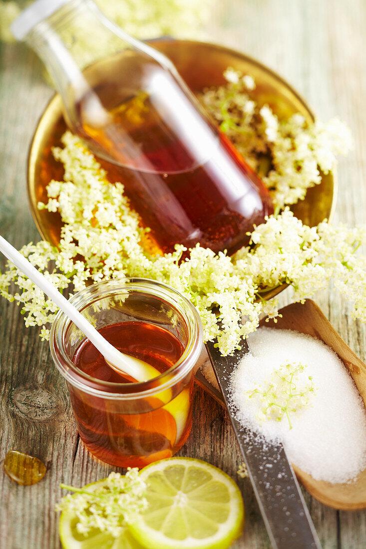 Homemade elderflower syrup in preserving jars