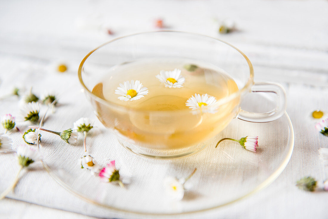 A cup of tea with daisies