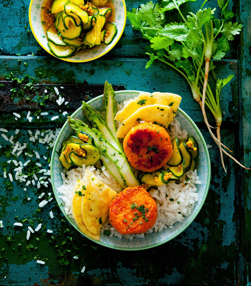 Indian bowl with jasmine rice, asparagus, sweet potato fritters, turmeric omelette and cucumber