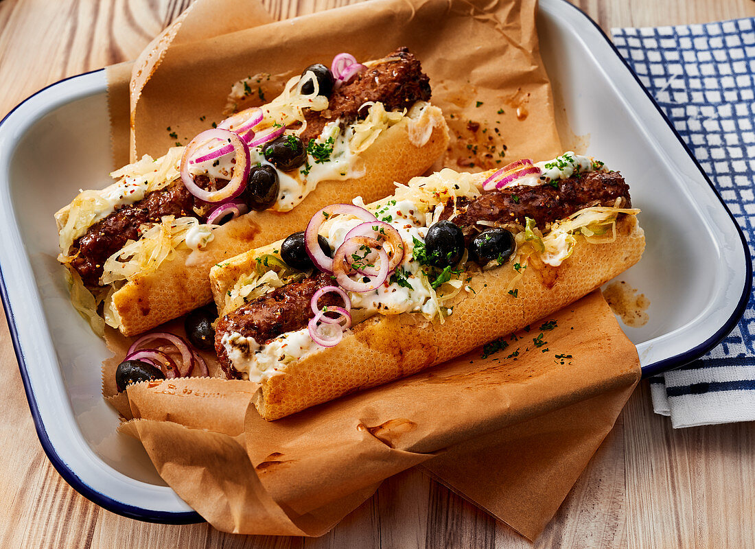 Greek-style hot dogs with bifteki and tzatziki feta cream