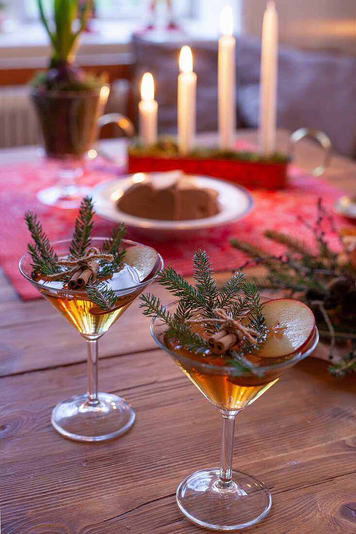Two festively decorated cocktails on rustic wooden table