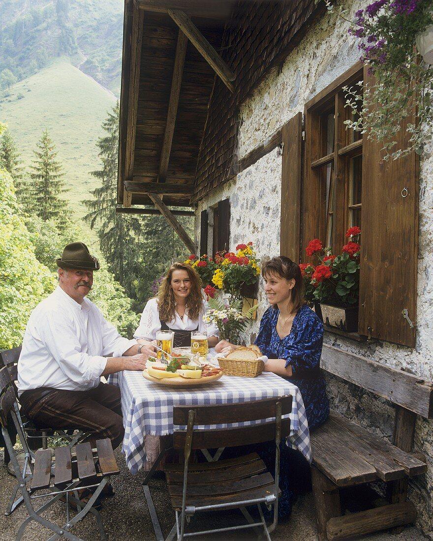 Lunch outside Engeratsgrund alpine hut: 2 girls & innkeeper