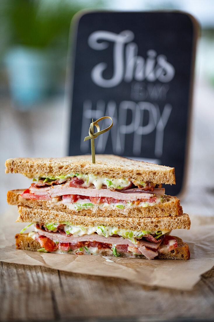 A club sandwich with turkey breast and bacon