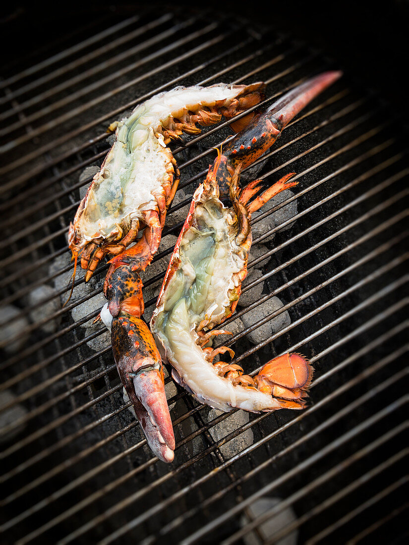 Fresh, halved lobster on a barbecue