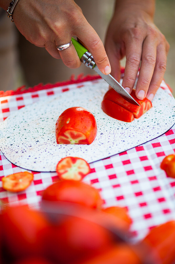 Tomatoes being sliced