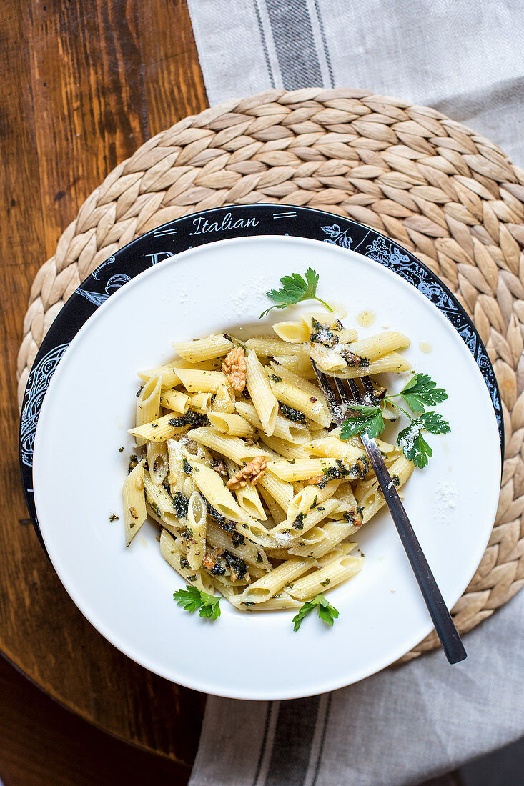 Penne pasta with pesto, walnuts and herbs