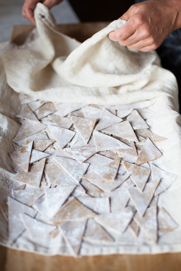 Homemade chestnut pasta drying on a cloth