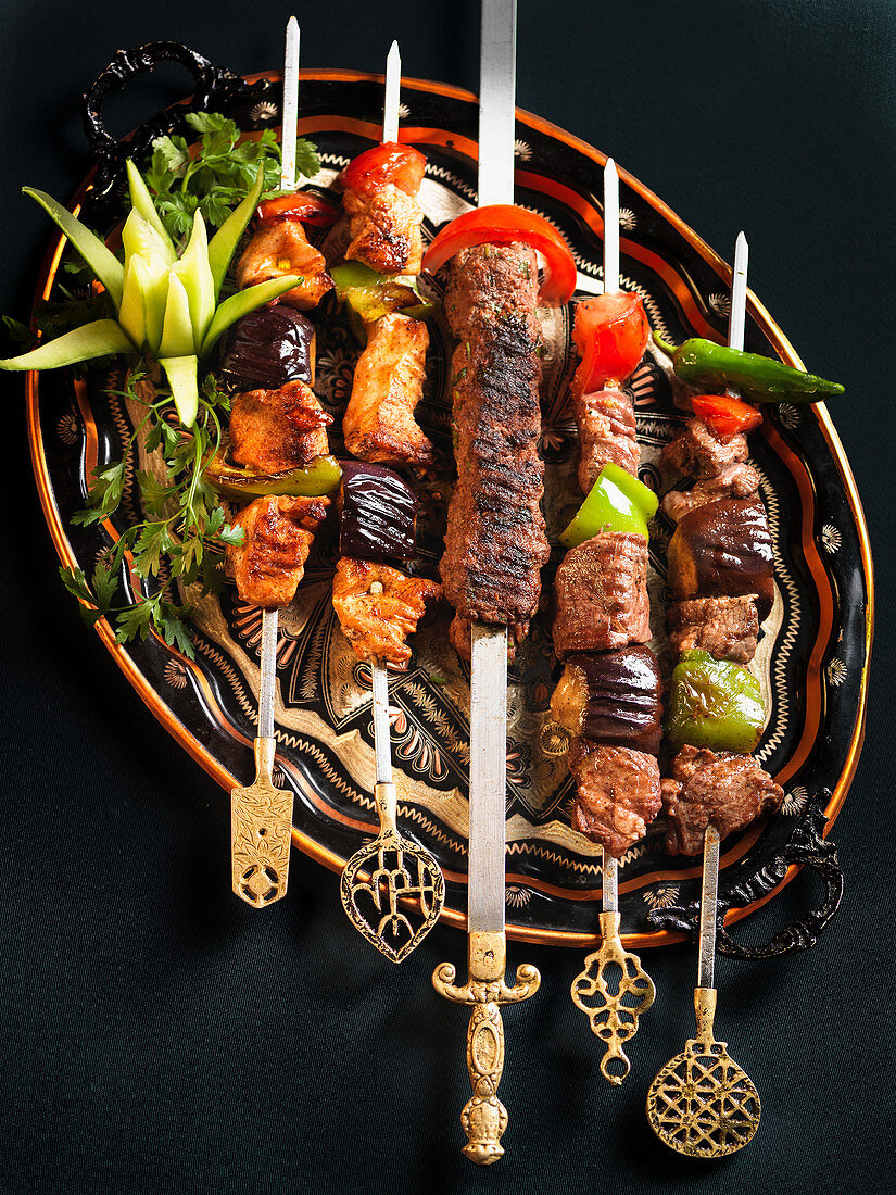 Lamb and chicken skewers with vegetables