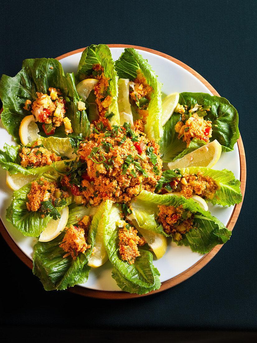 Tabbouleh on lettuce leaves
