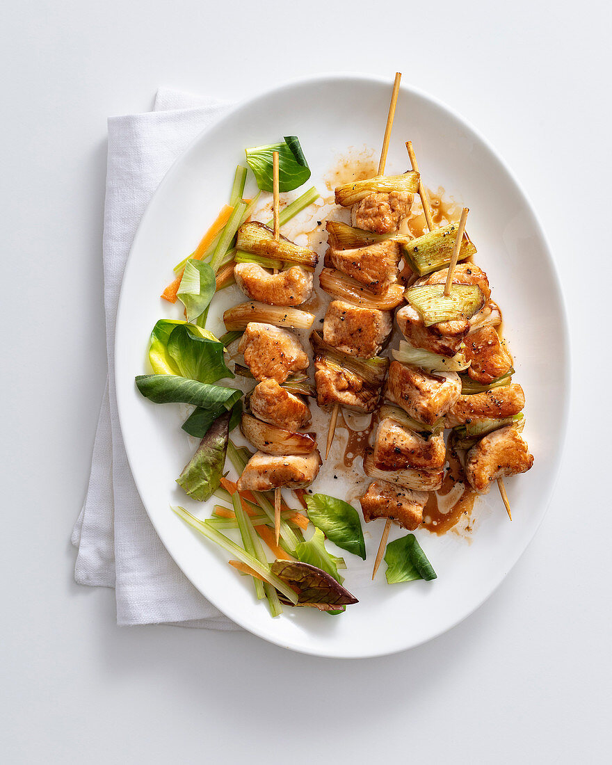 Chicken and shallot skewers with a Coca Cola glaze