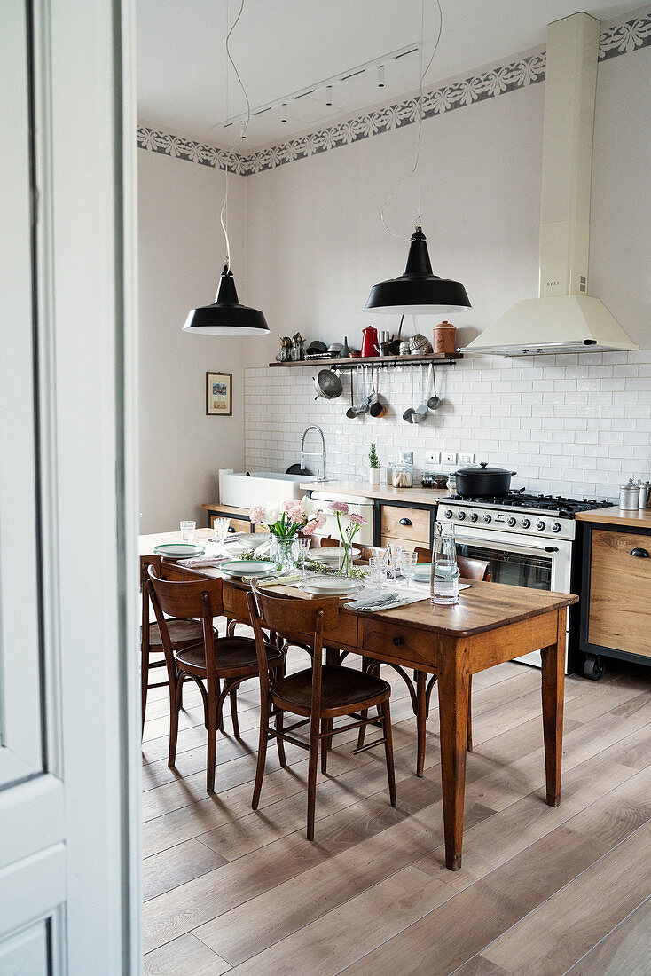Set dining table in bright, spacious kitchen