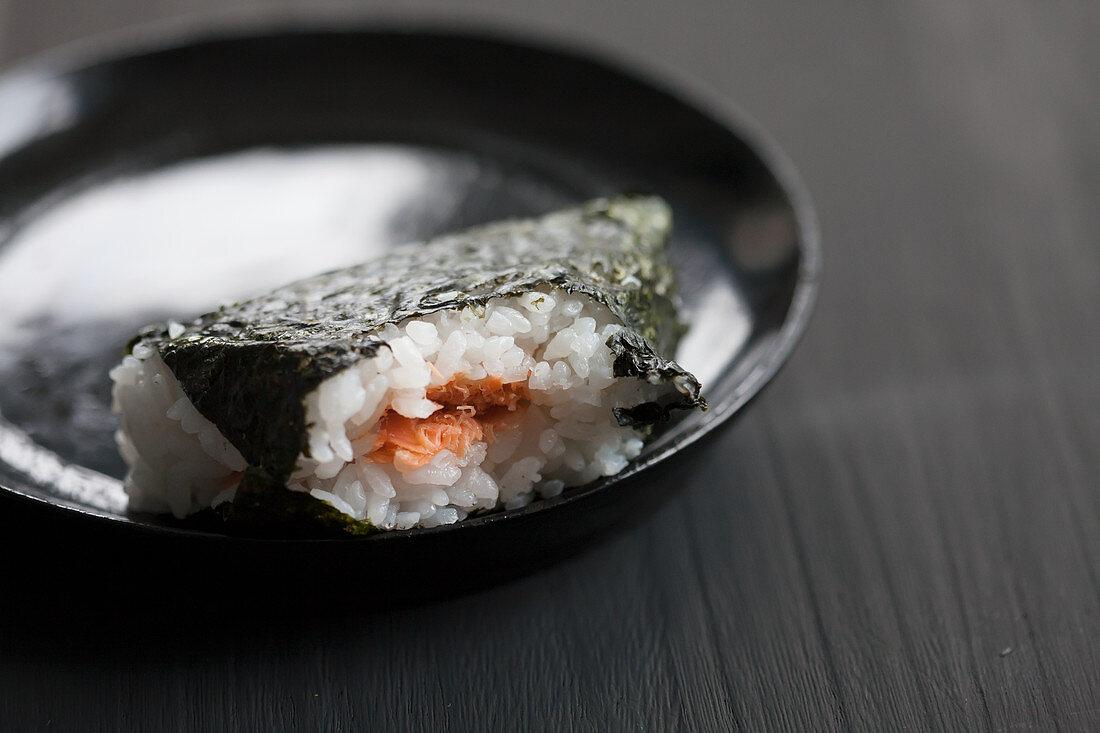 Bitten onigiri filled with salmon (Japan)