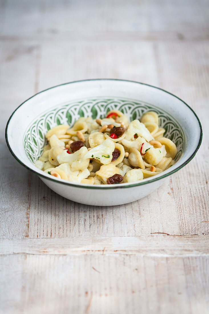 Orecchiette pasta with cauliflower, sultanas and onions (Sicily)