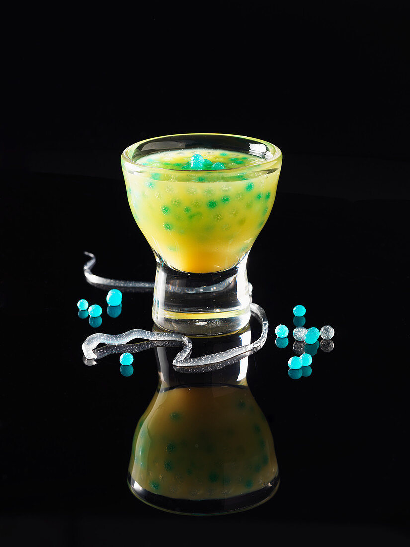 A play of coloured drops in orange juice (molecular gastronomy)