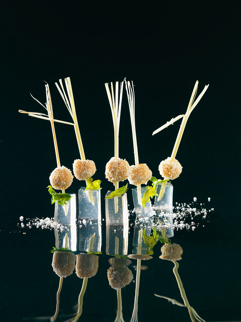 Chicken pralines on lemongrass cubes (molecular gastronomy)