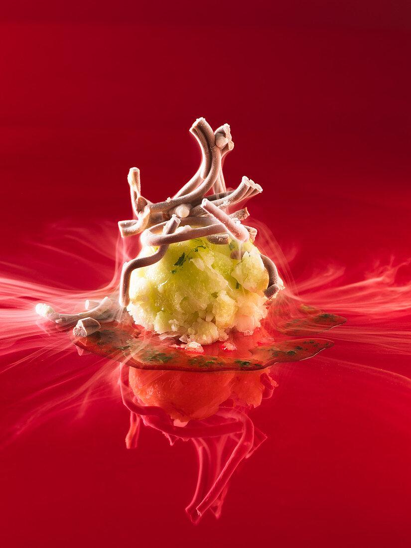 Chocolate spaghetti on sweet pesto with lime ice cream (molecular gastronomy)