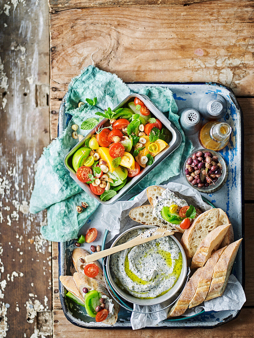 Seeded goats cheese spread with tomato salad and baguette