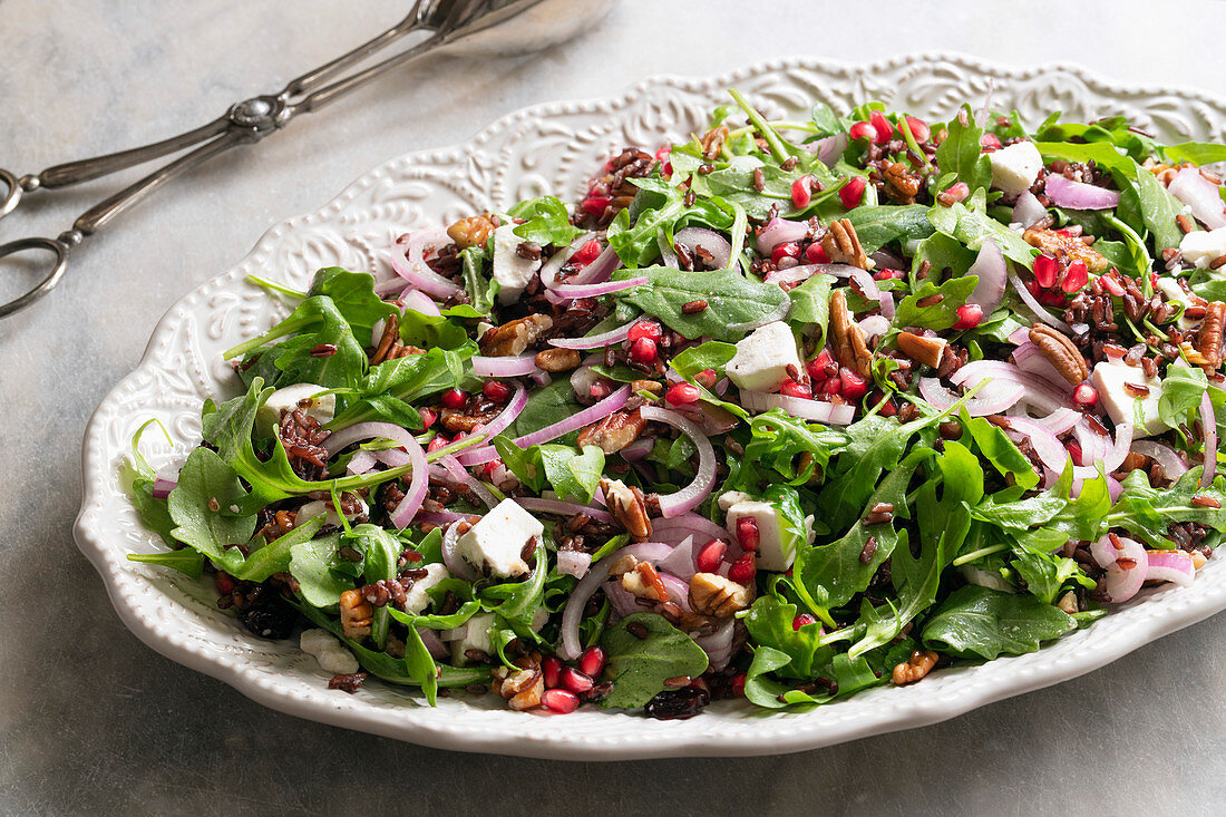 A healthy rocket, pomegranate and rice salad