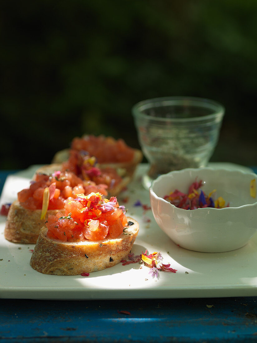 Bruschette with tomatoes and edible flowers