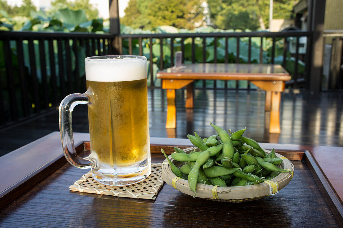 Ice cold beer with salted, cold edamame (Japan)