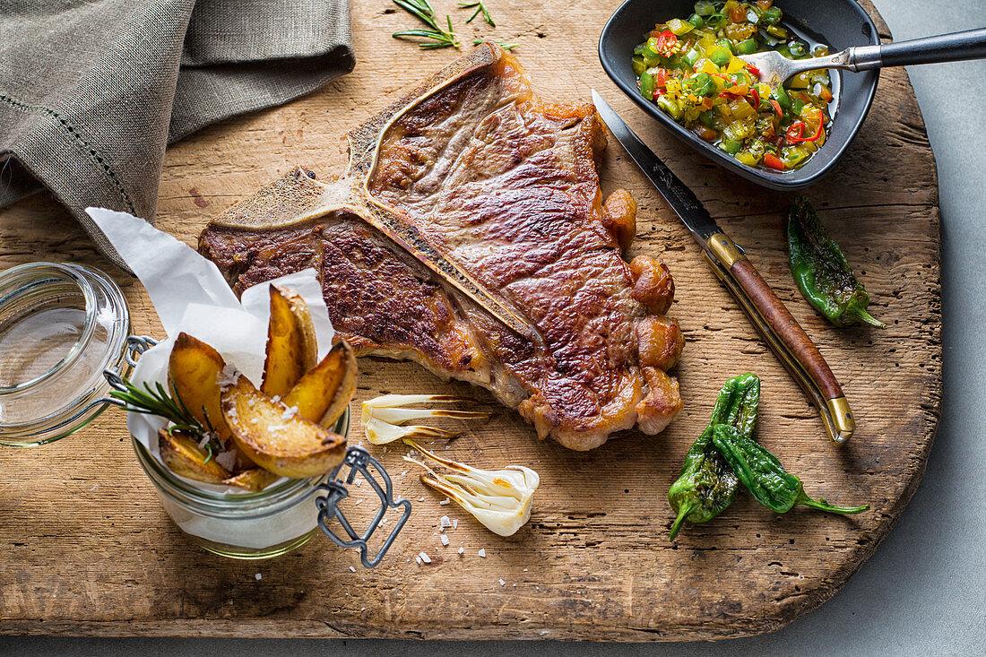 T-bone steak with potato wedges