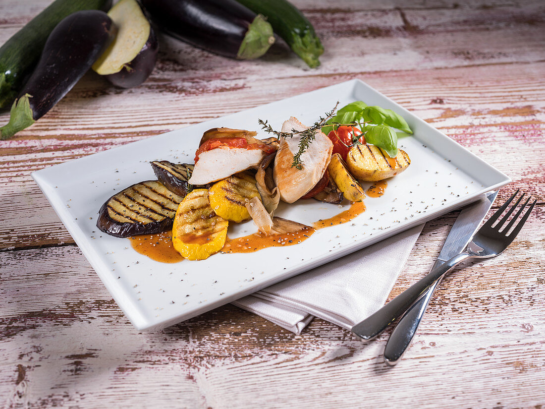 Roasted chicken breast with grilled potatoes and vegetables