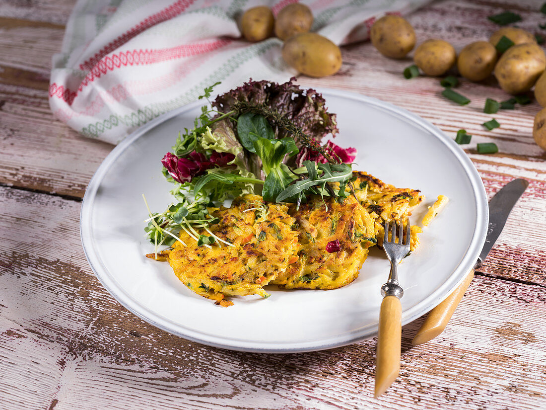 Potato and rocket patties with salad and cress