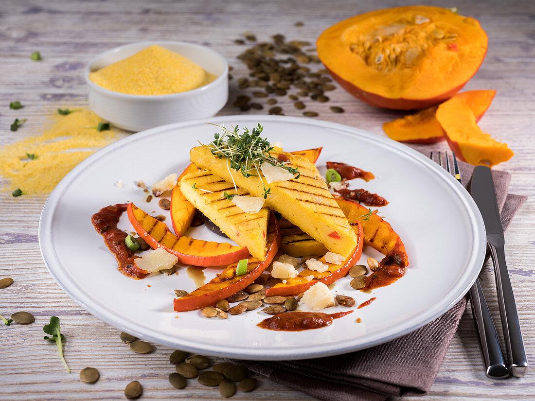 Pumpkin polenta with pumpkin seeds, cress, tomato sauce and parmesan