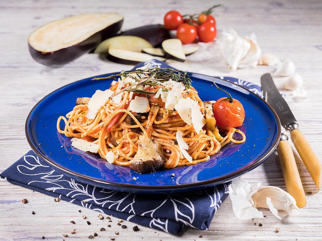 Spaghetti Siciliana with aubergine, cherry tomato, parmesan, thyme, rosemary and garlic