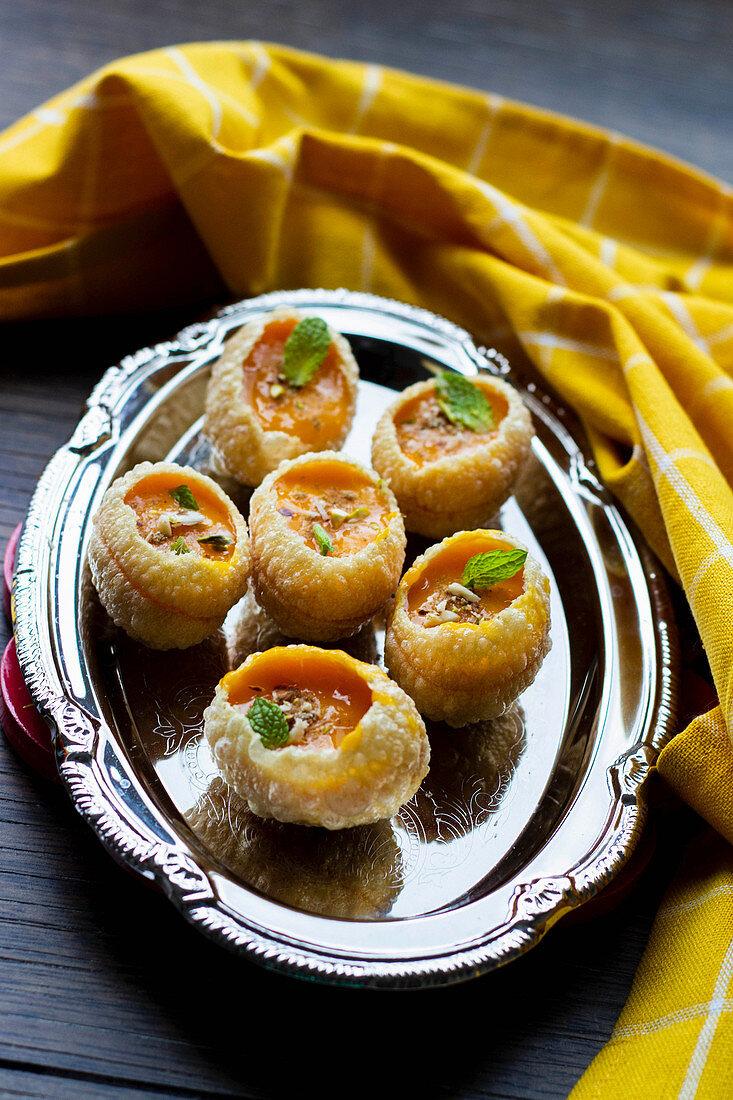 Aamrus Puri, pastry with mango mousse (India)