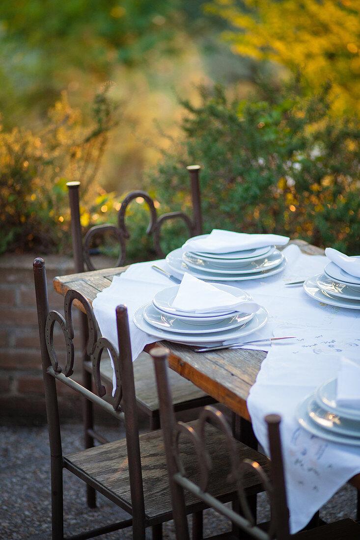 A table laid on a restaurant terrace (Italy)
