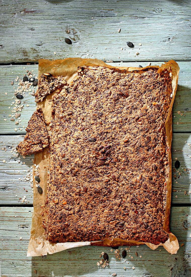 Norwegian Wunderbröd, sliced, on baking paper