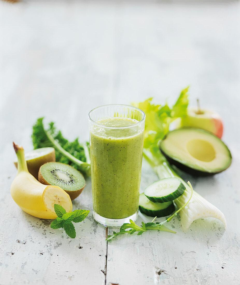 A smoothie made from kiwi, banana, avocado, celery and apple