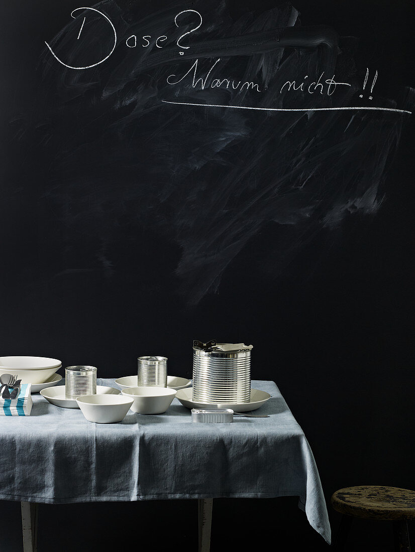 Tins and crockery on a table