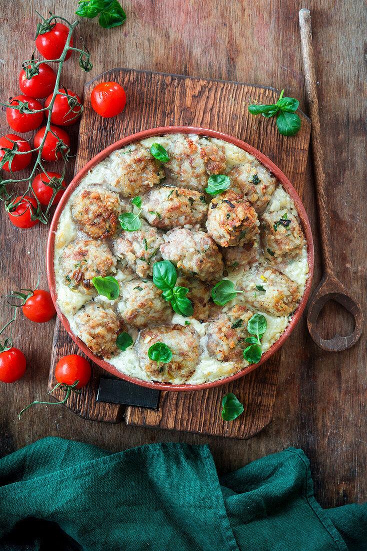 Rice meatballs baked in cream