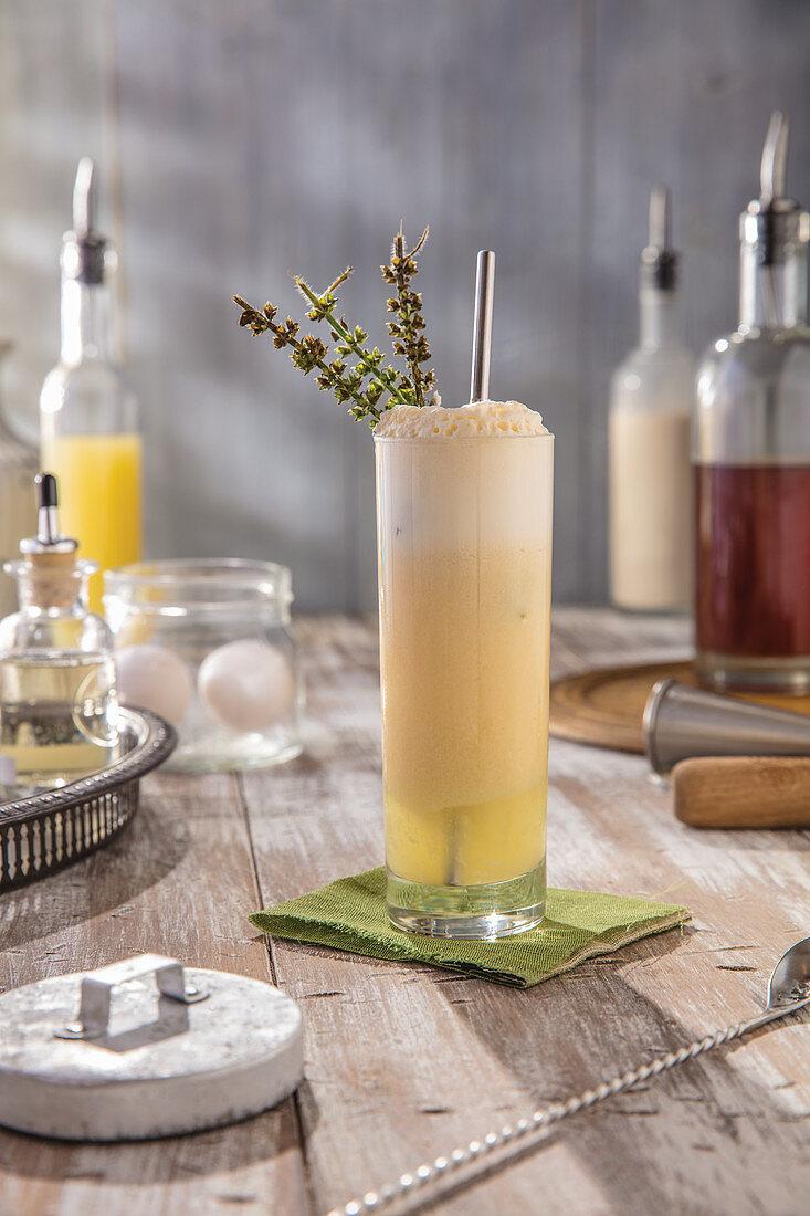 Cream fizz with lavender sprig garnish